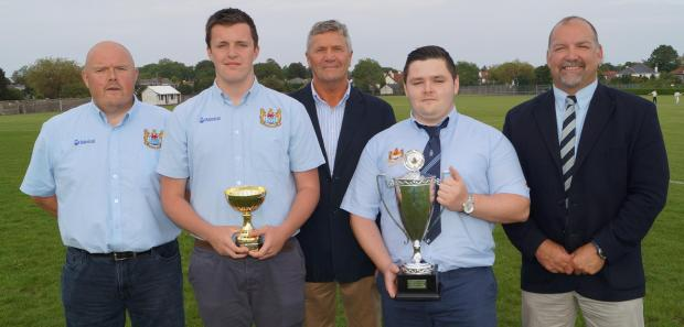 TROPHY SUCCESS: Celebrating the Penarth Rugby Club youth team's league success with captain Connor Kavanagh (second right) and vice-captain Mason Goode are coaches Colin Laity, Richard Smith and Andy Pyman.