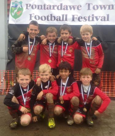 VICTORY SMILES: Celebrating their victory at the annual Pontardawe Town Football Festival are the Penarth Town U8s.