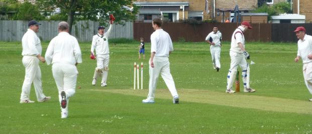 FOUR-WICKET HAUL: Dinas Powys Seconds' Richie Morgan, who produced a great spell of four wickets for five runs, bowls a Tondu batsmen but it was