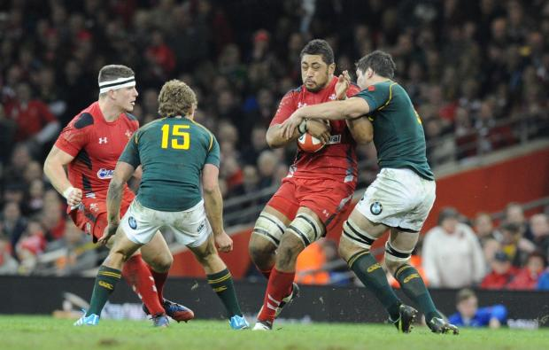 Penarth Times: Toby Faletau is tackled by Francois Louw (2397256)