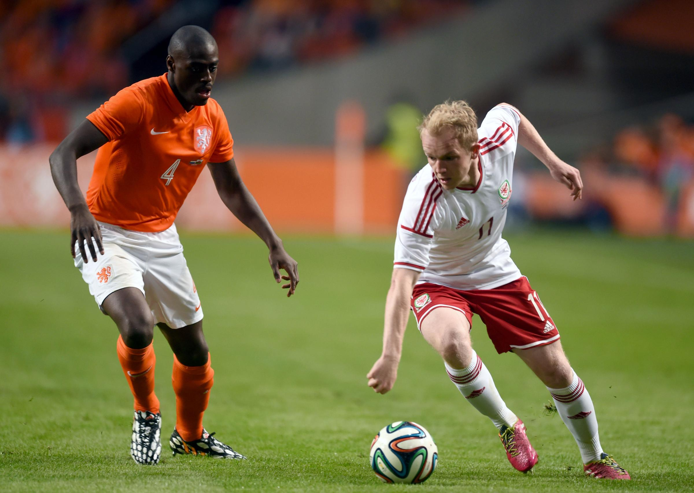 Netherlands' Bruno Martins Indi (left) and Wales' Jonathan Williams battle for the ball during the Friendly at the Amsterdam Arena, Netherlands. PRESS ASSOCIATION Photo. Picture date: Wednesday June 4, 2014. See PA story SOCCER Wales. Photo credit