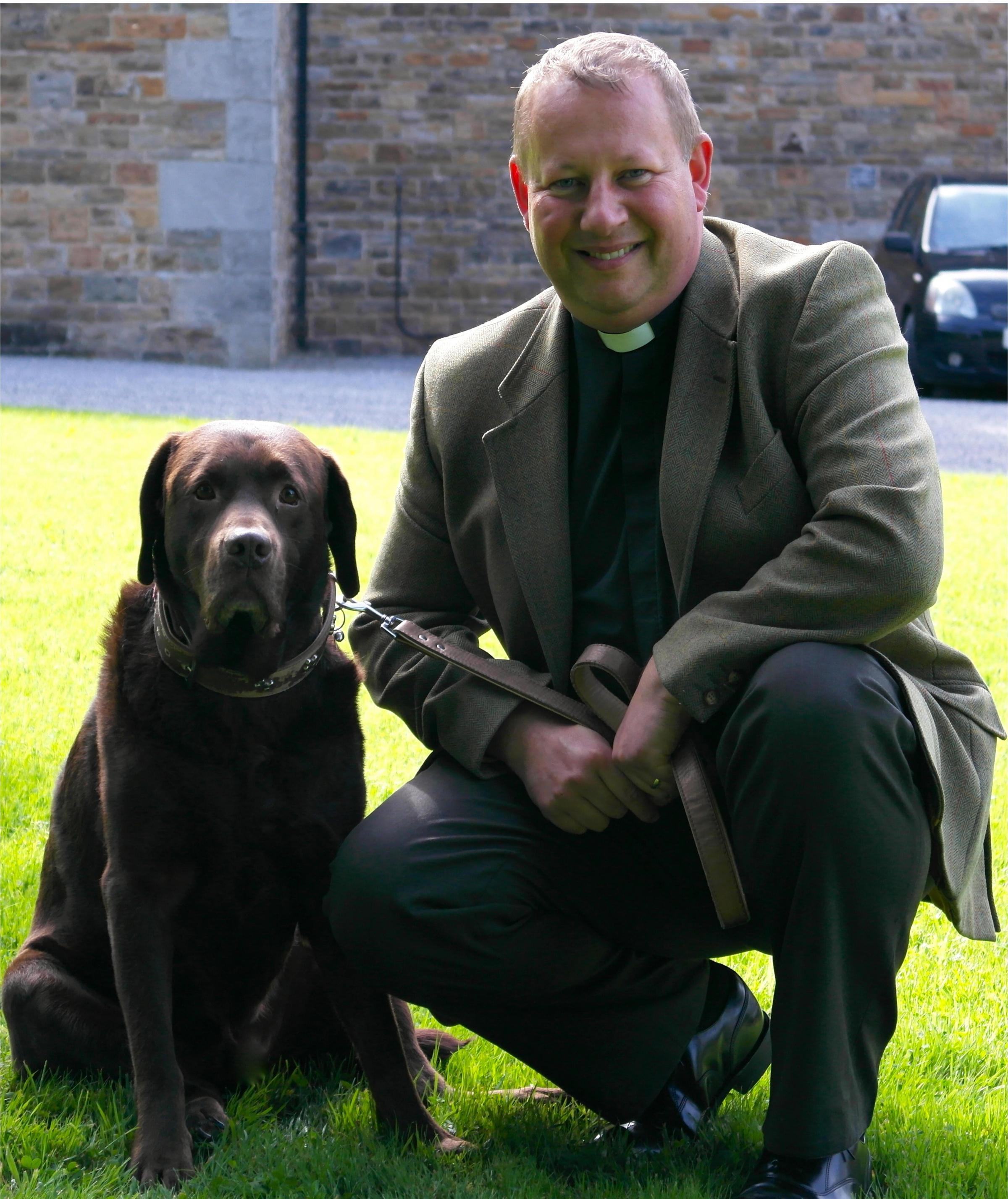 MANS BEST FRIEND: Revd Andrew James with his labrador Coco