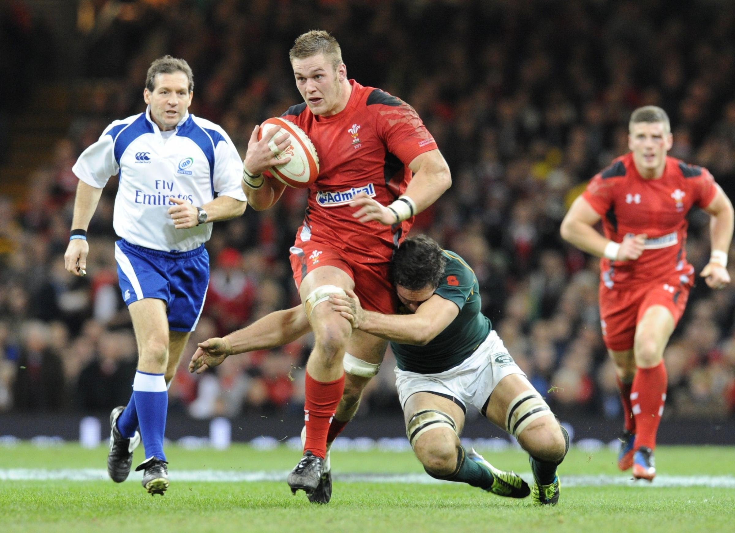 Dan Lydiate is tackled by Francois Louw (2397191)