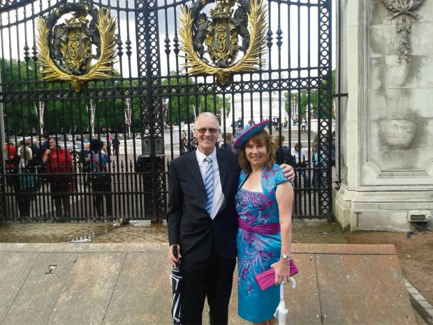 GARDEN PARTY: Hats4Heroes founder Tina Selby with her husband Brian at the gates of Buckingham Palace