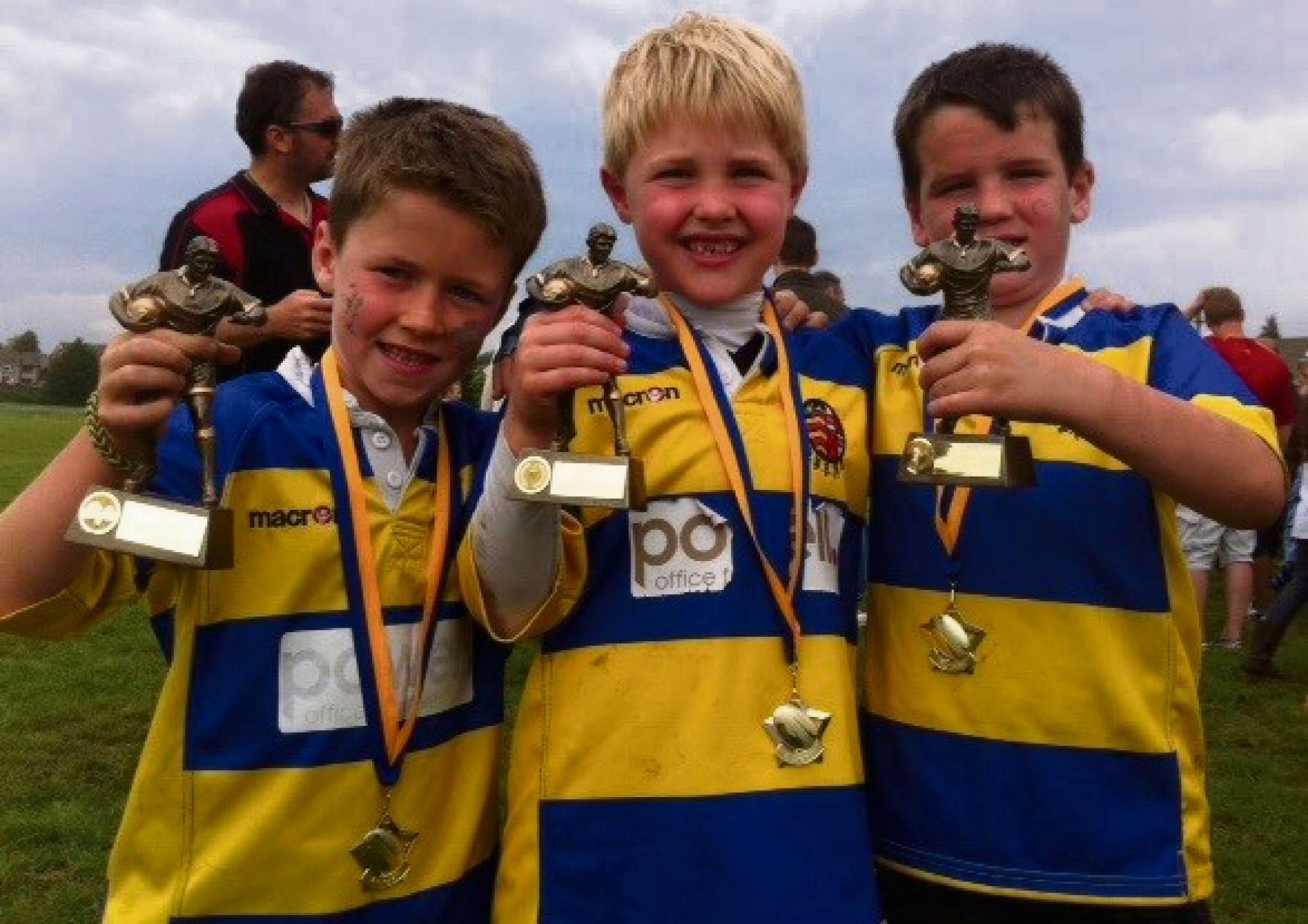 MEDALS AND TROPHIES: Haydn Craven, Joshua King and Oliver Long. U7s Trophy winners 2014