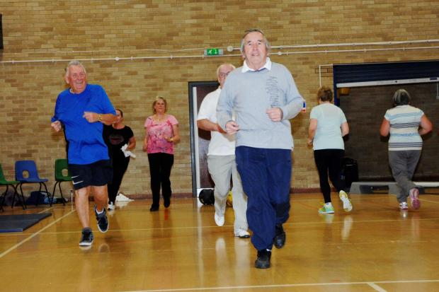 WORKOUT: Cllr Gwyn John gets a workout along with members of the GP referral scheme at Barry Leisure Centre. (7172338)