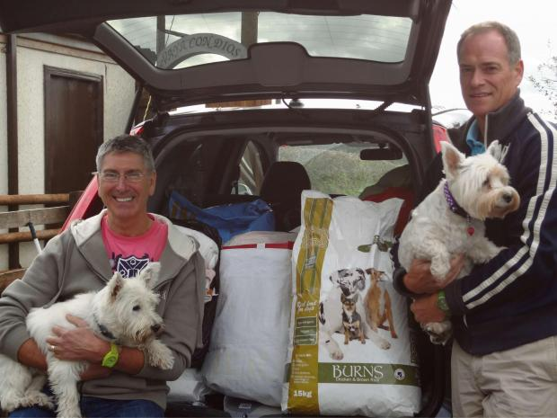 ANIMAL LOVERS: Andy Bradshaw (left) with Westie Georgie and Peter Knowles with Westie Millie