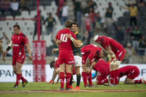 Penarth Times: Dan Biggar of Wales, left and Morne Steyn of South Africa middle after South Africa win the match 31 - 30 during their Rugby test match in Nelspruit, South Africa, Saturday, June 21, 2014. (AP Photo). (7386032)
