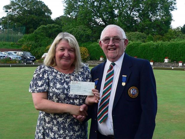 A  CHEQUE for £1,360 was recently presented by vice president Dave Dalby of Penarth Bowling Club to Karen Jones of Penarth's Marie Curie Hospice, Br