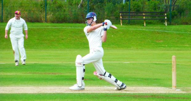 Penarth Times: BATSMAN'S DEBUT: Dinas Powys Cricket Club 2nd XI debutant Jack Fleckney tries to up the scoring rate against Malpas.