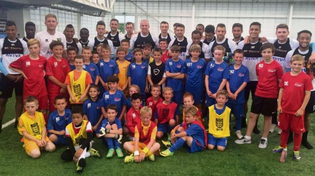 DEVELOPING FOOTBALLERS: Youngsters who attend PG10 development centres in the Vale were among those taking in a football development day at the home of English football - St George's Park - where they were joined by members of Championship club Norwic