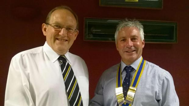 TALK: Gwyn Roberts of the Royal Mint being thanked by the club's new president Colin Jones