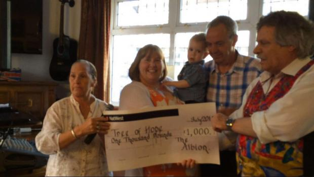 CHEQUE: (from left) Liz High, Fiona, Alfie and Rod, and Richard Bond with the cheque