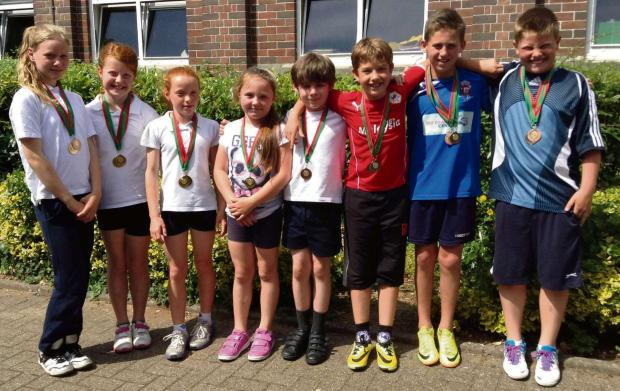 SPRINTERS: Top sprinters from Years 3 to 6 at Sully primary school picked up silver medals after taking part in an athletics event involving other local primary schools.