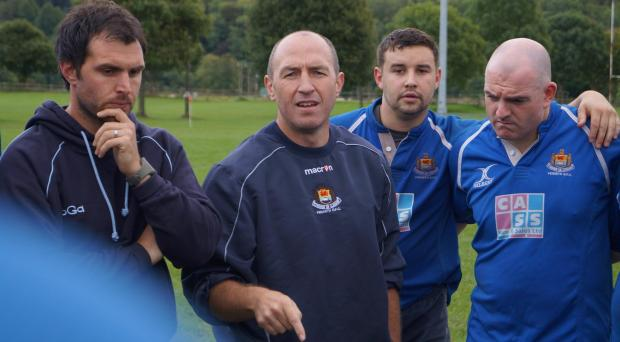 COACHING ADVICE: Penarth Rugby Club flank forward Matt Sutton (second right) listens intently to pre-season words of wisdom from - from left, Grant Robson (backs coach), Paul Williams (head coach) and David Morgan (forwards coach).