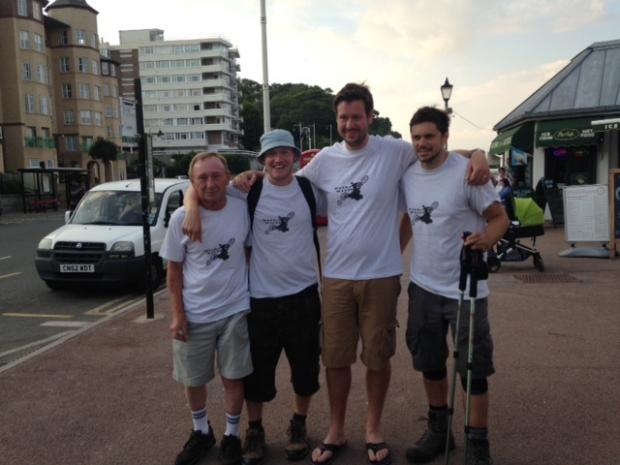 WALKERS: (left to right) Dave Naylor, Andy Naylor, Ben Russon and Phil Stubbs after finishing the walk at Penarth Pier