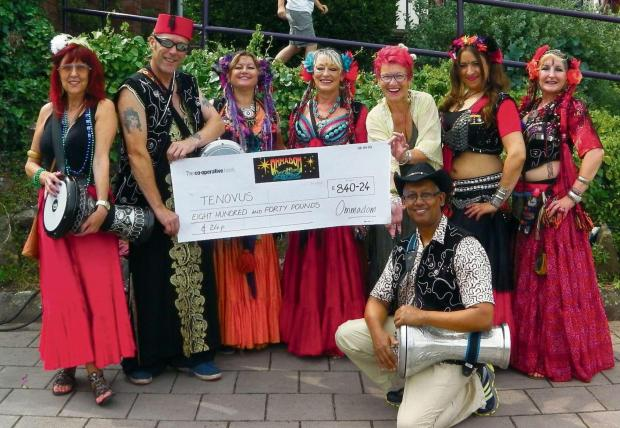 BELLY DANCERS: Ommadom presenting a cheque to Tenovus (8473232)