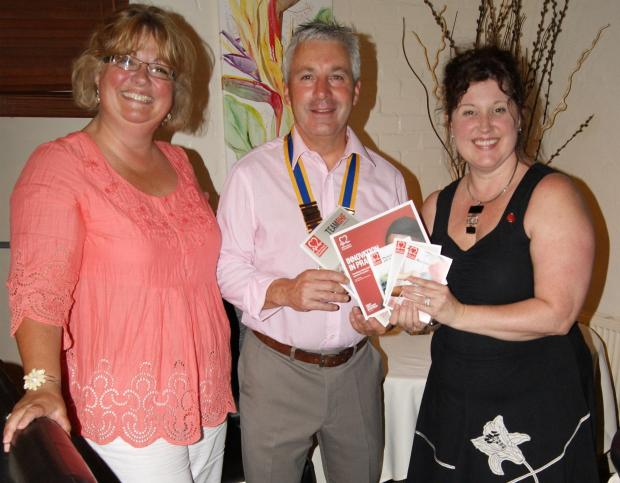 EXCELLENT EVENING: Club president Colin Jones receiving some of the public information booklets from Catherine Campbell and Jayne Rookes of the BHF. (8699796)