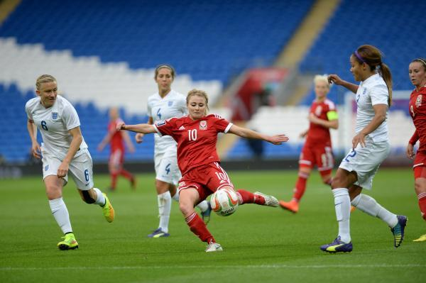 CLOSE: Wales striker Sarah Wiltshire goes for goal against England