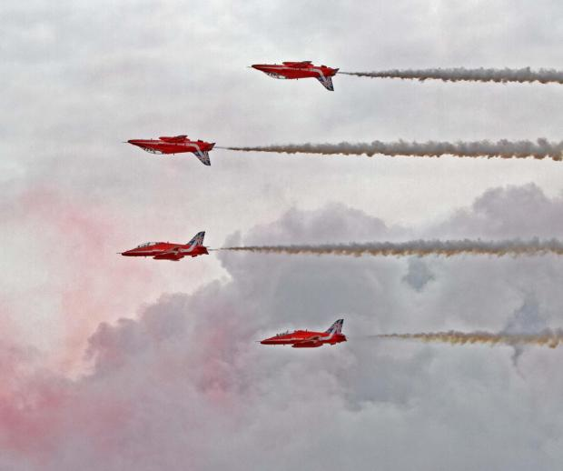 SOARING: The Red Arrows fly over Barry Island. PIC:Tina Haydon