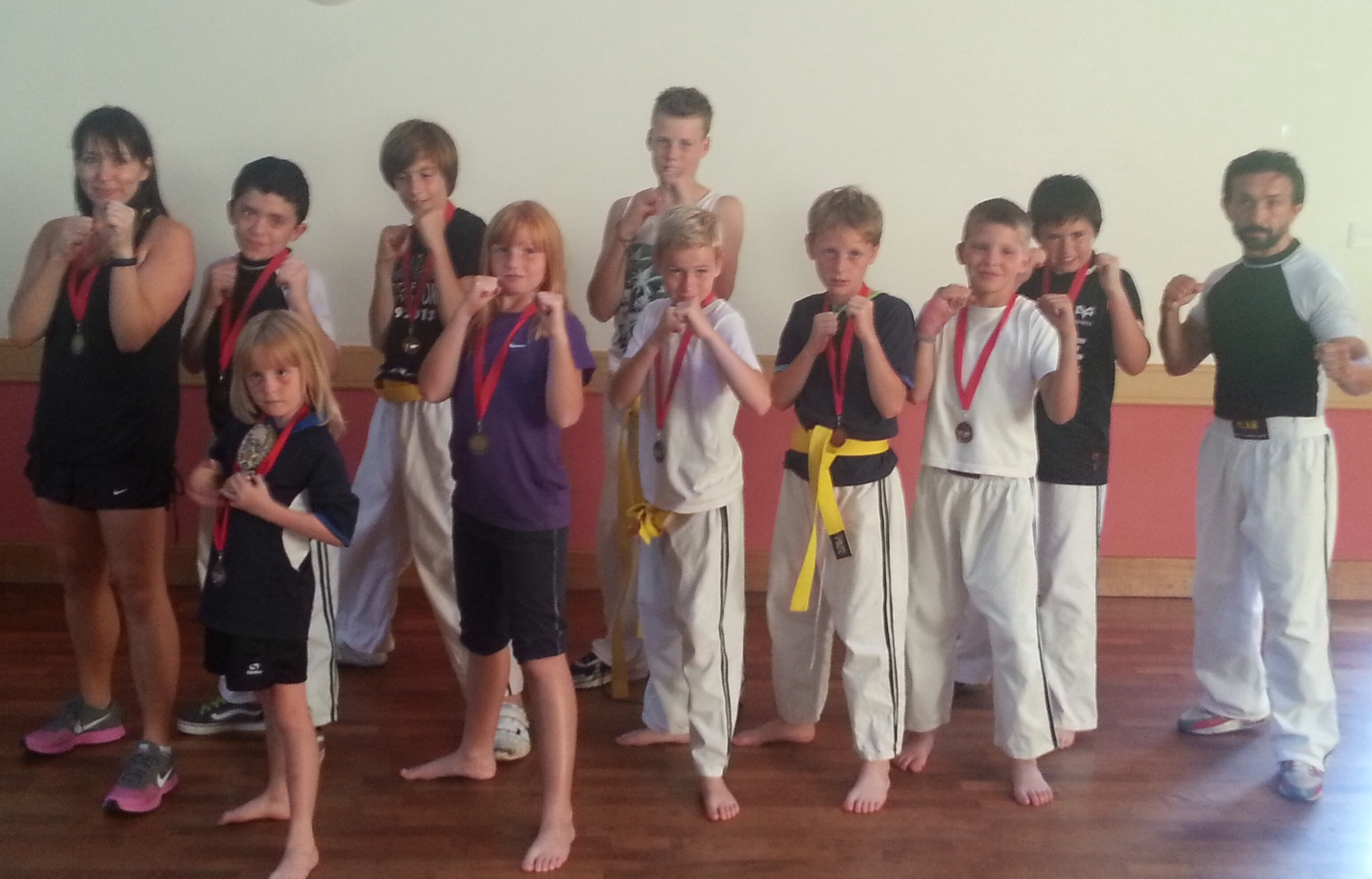 SUCCESS: Children with their new belts and medals