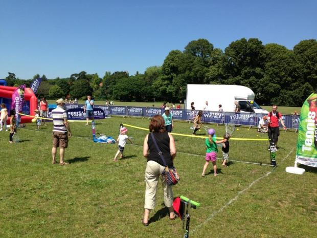 ANYONE FOR TENNIS? Hundreds of people of all ages have tried tennis this summer