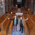 Penarth Times: NEW CHOIR: Revd Andrew James and choirmaster James Bingham with the empty choir stalls waiting to be filled