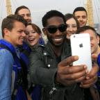 Penarth Times: Tinie Tempah takes a selfie with fans at The O2 arena in London