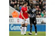 Papiss Cisse, right, has apologised over the incident with Jonny Evans during Newcastle's defeat against Manchester United