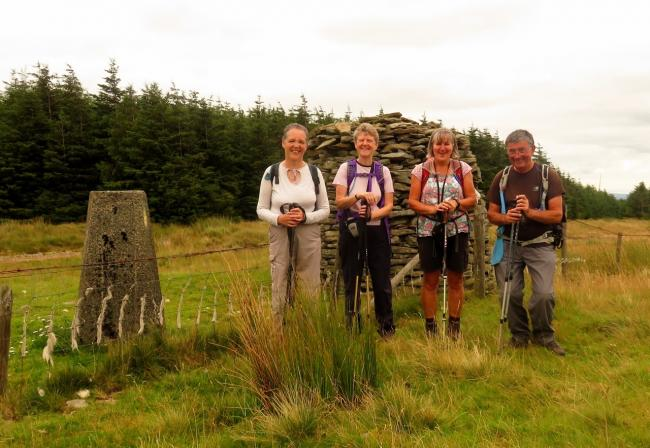 Walkers at the trip point at Mynydd William Meyrick