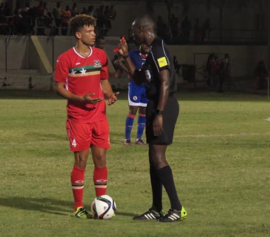 DEBUT: Cwmbran's Theo Wharton takes instruction from the referee while playing for St Kitts & Nevis against Haiti