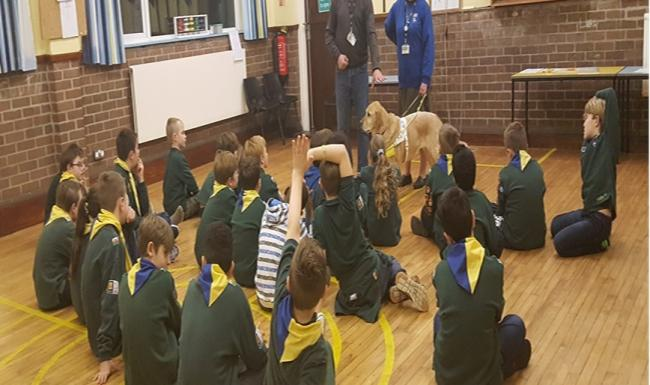 Yolena the guide dog was one of the guests to visit Dinas Powys 1st Cubs