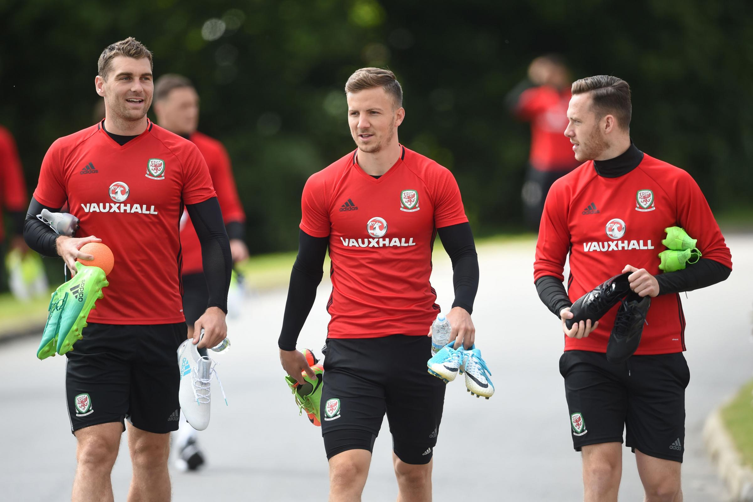 NATIONAL SERVICE: Former Newport County star Lee Evans, centre, with Wales teammates Sam Vokes, left, and Gethin Jones, right