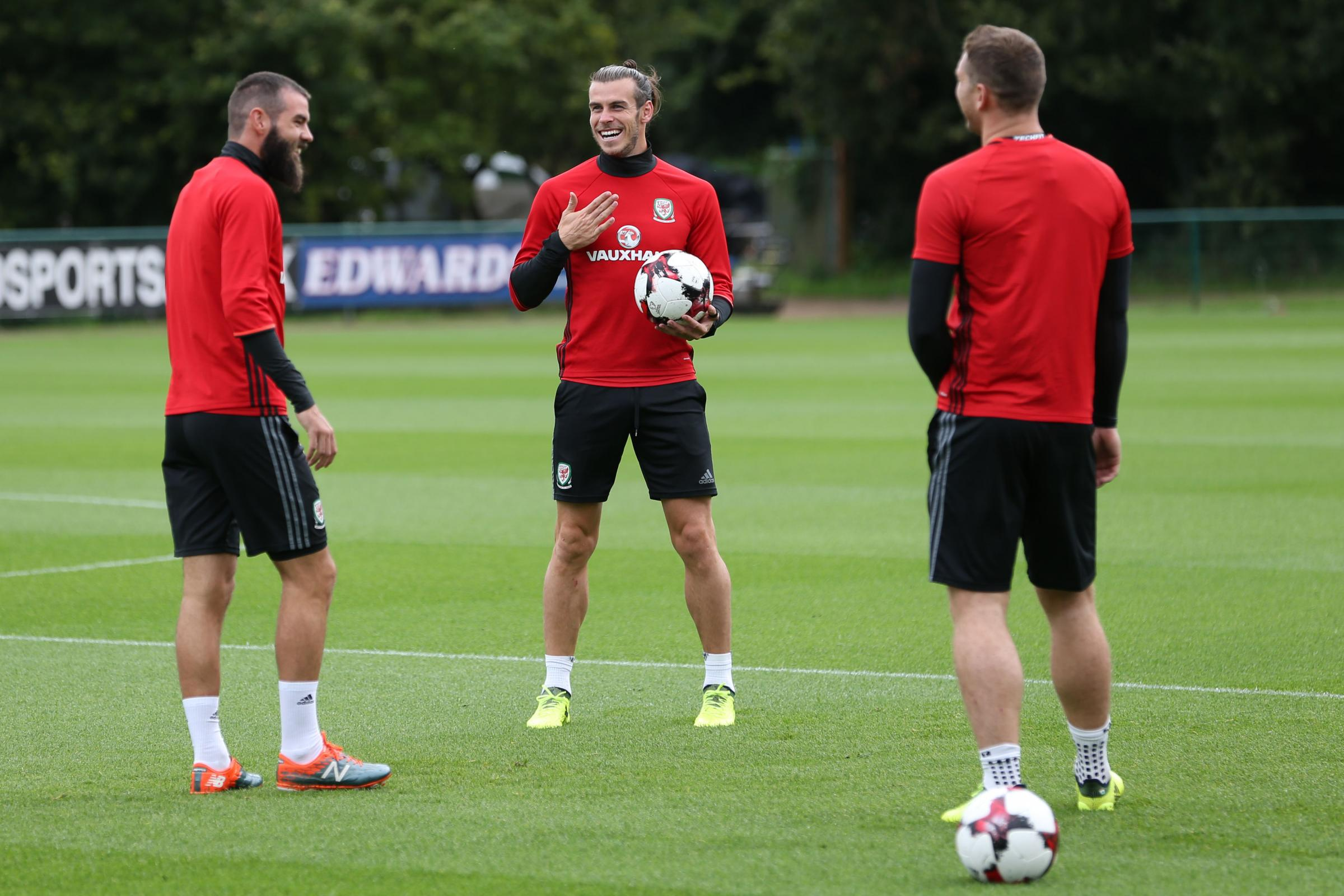 RELAXED: Gareth Bale shares a joke with Wales teammates Joe Ledley and Sam Vokes during Tuesday's training session at The Vale Resort