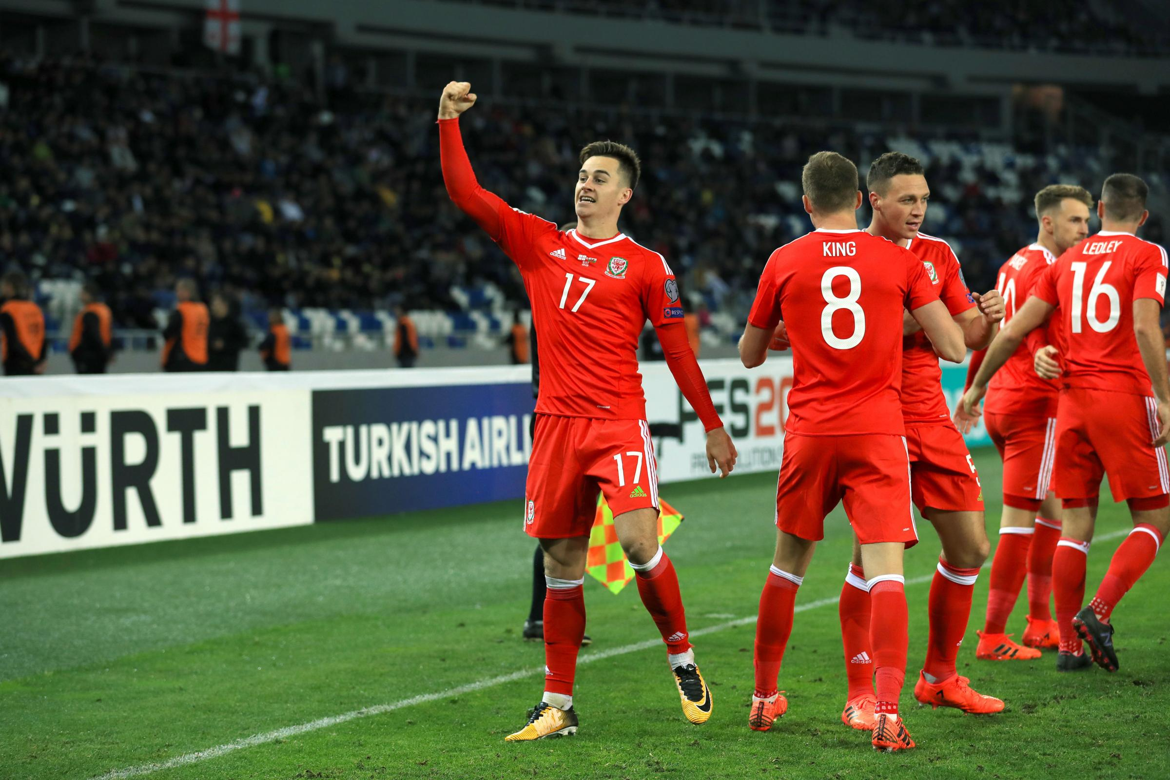 JOY: Tom Lawrence celebrates his winner for Wales in Georgia