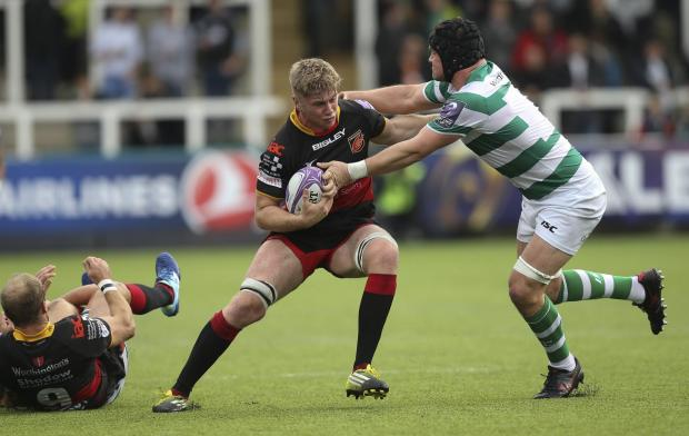 Penarth Times: SHOCK CALL-UP: Aaron Wainwright carries the ball for the Dragons at Newcastle in the European Challenge Cup