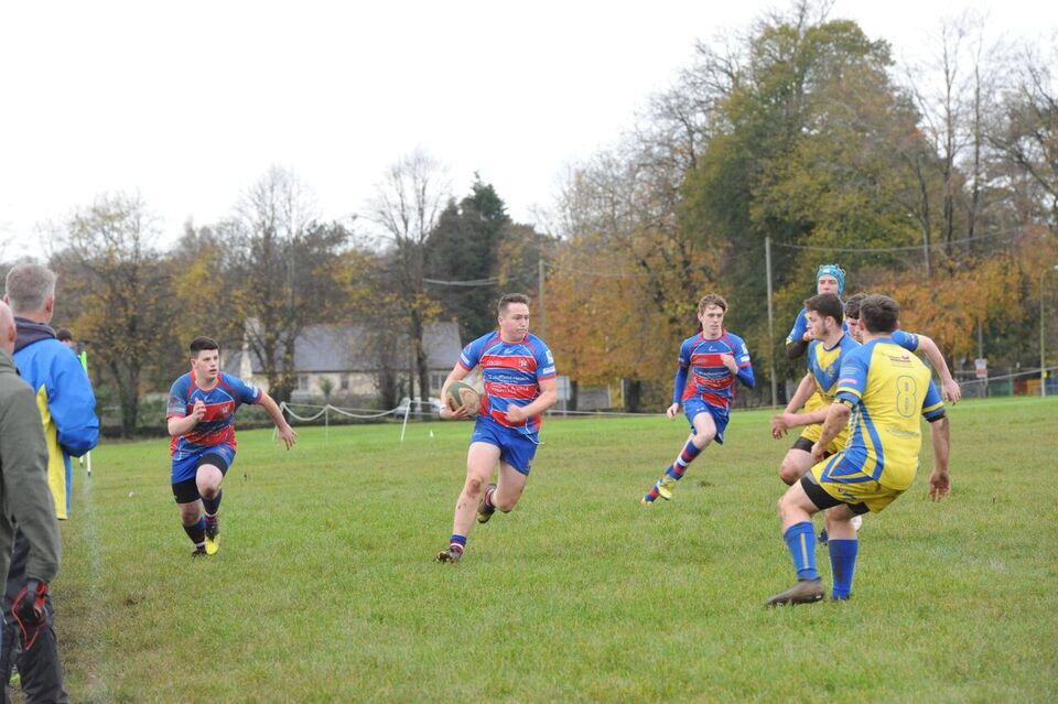 Penarth flanker Ellis Smith making a break against Dinas Powys supported by prop Matt Hocking and wing Zacc Fillau
