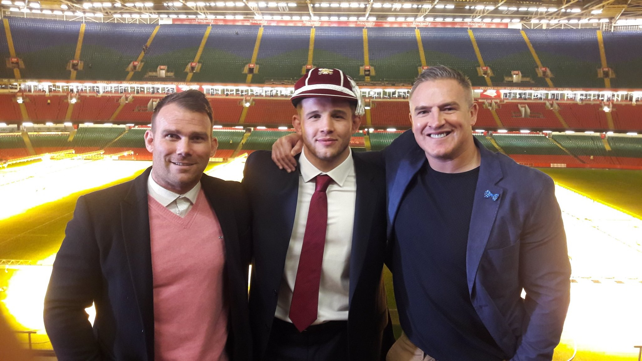 INTERNATIONAL CLASS: Dragons hooker Elliot Dee celebrates his first cap with Gavin Rees and former Wales centre Matthew J Watkins, his agents at SRW Sports (Picture: SRW Sports)