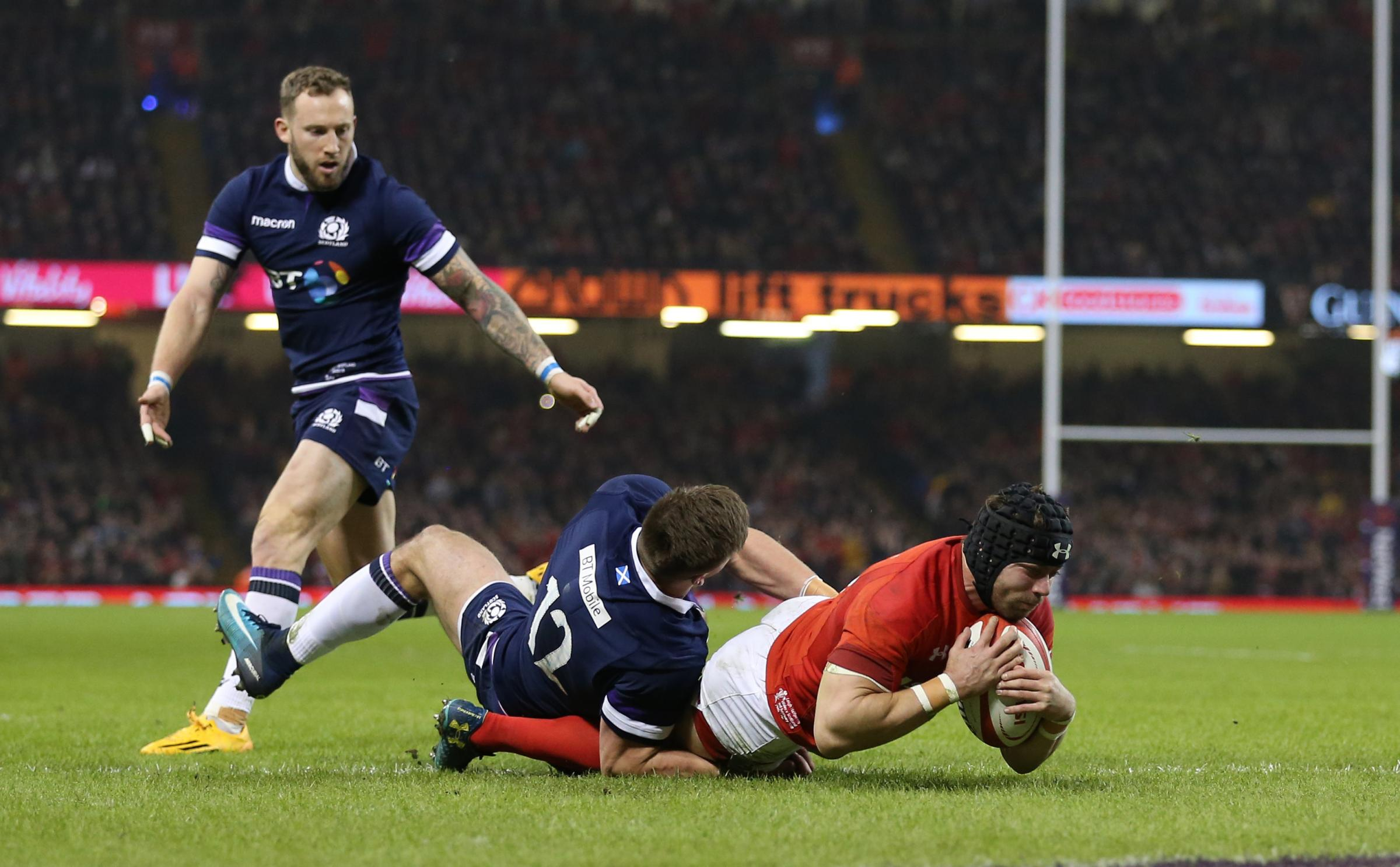 TRY TIME: Leigh Halfpenny dives over for Wales' second try