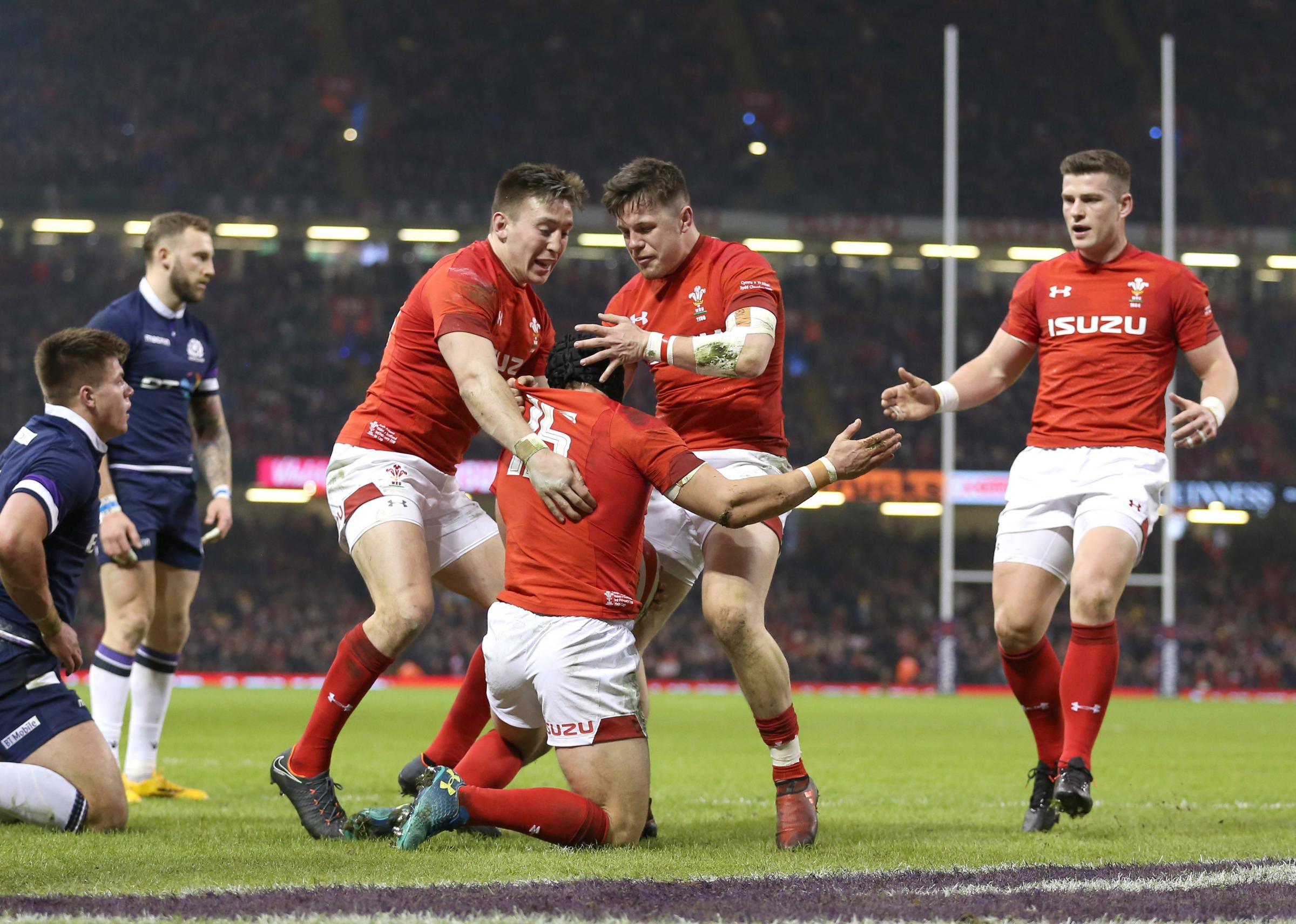 GREAT START: Scott Williams (far right), Josh Adams and Steff Evans congratulate Leigh Halfpenny after his first try. Picture: Nigel French/PA Wire