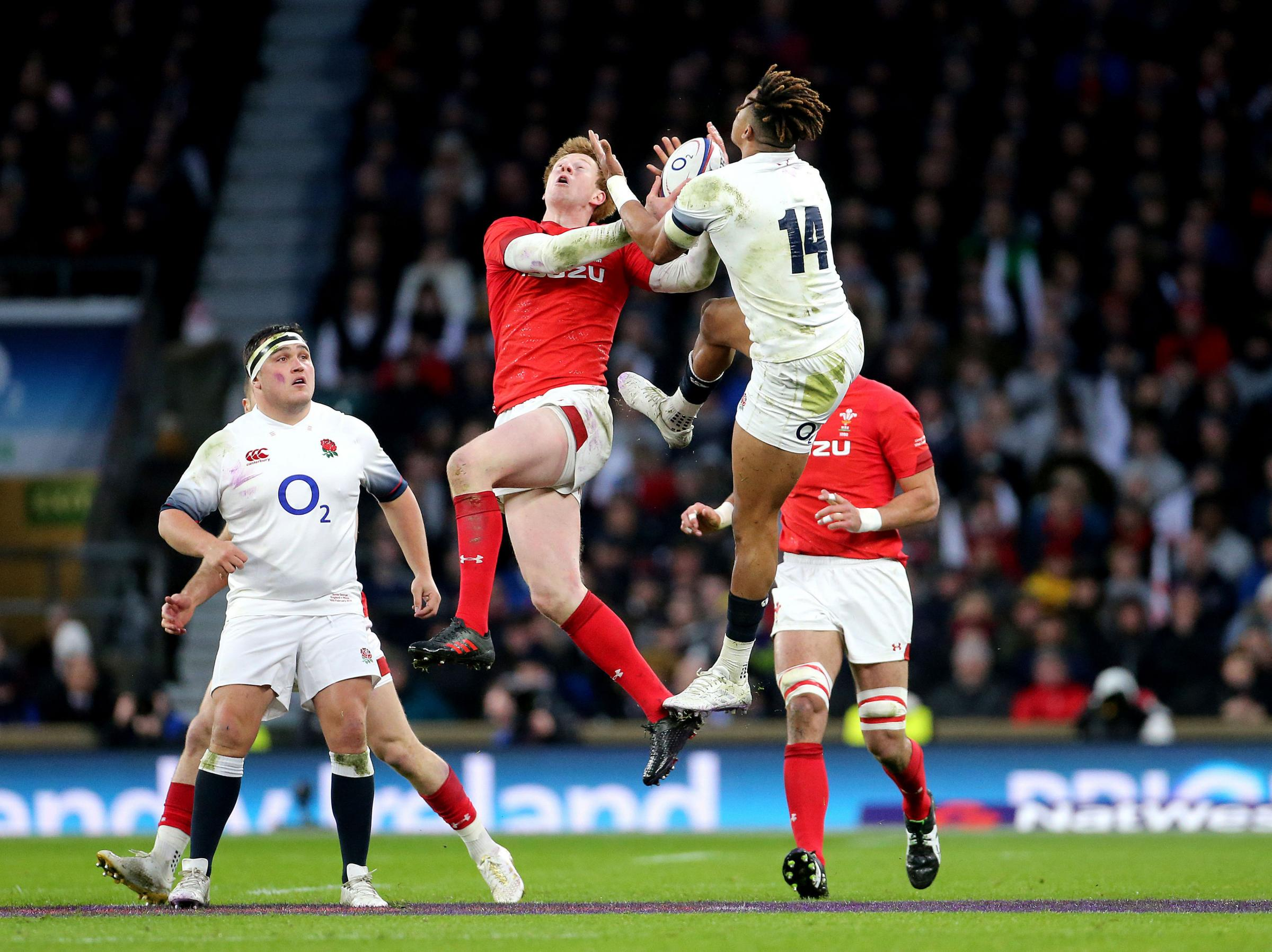 SECOND BEST: Rhys Patchell is beaten to the ball by Anthony Watson as Wales were beaten in the aerial battle