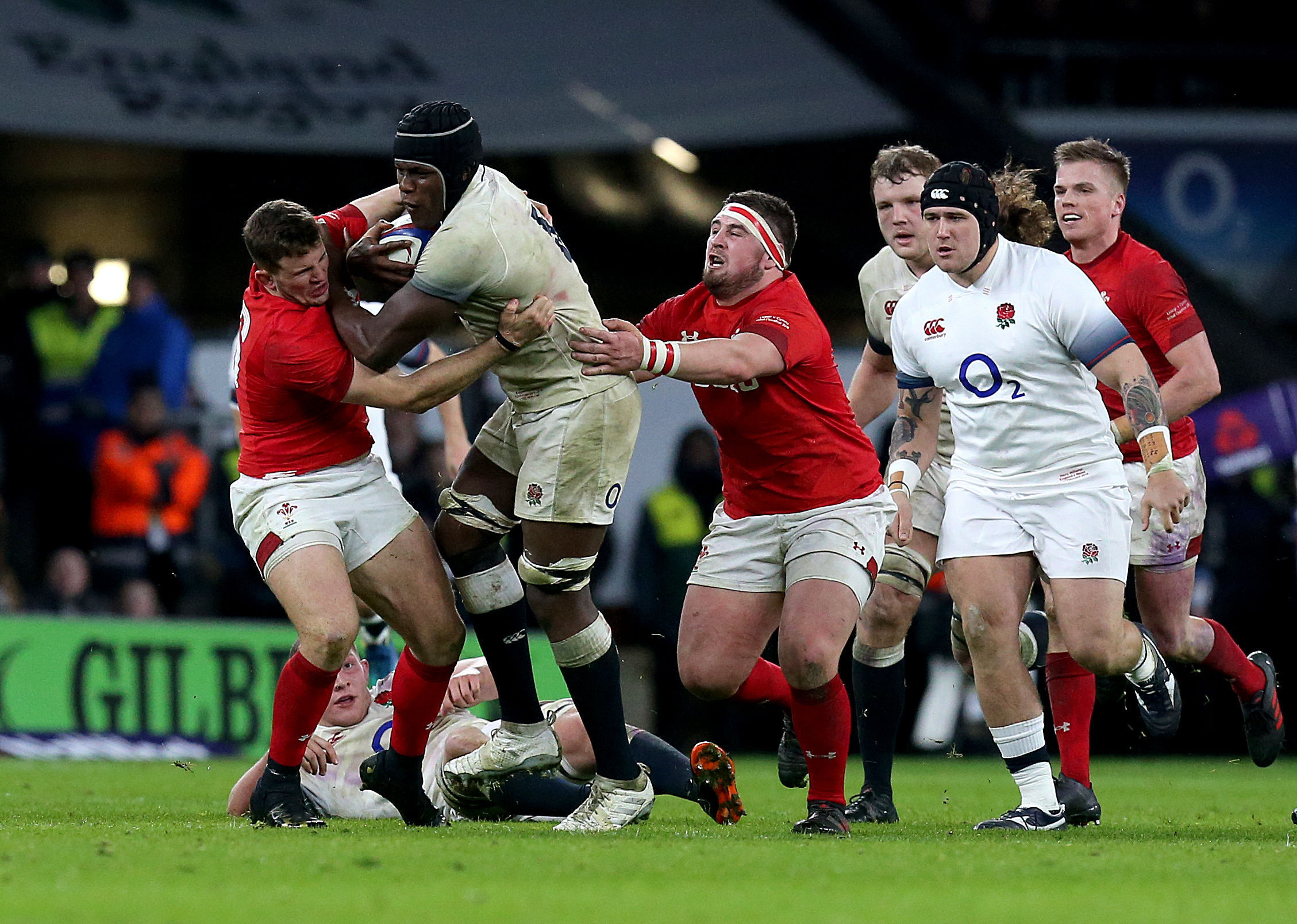 HOPEFUL: Dragons hooker Elliot Dee, pictured tackling Maro Itoje, is hoping for a first Wales start against Italy