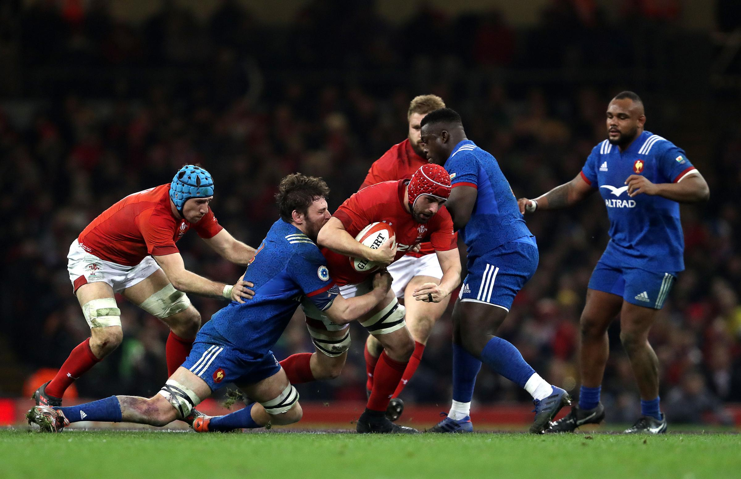 ON THE CHARGE: Dragons lock Cory Hill carries hard for Wales
