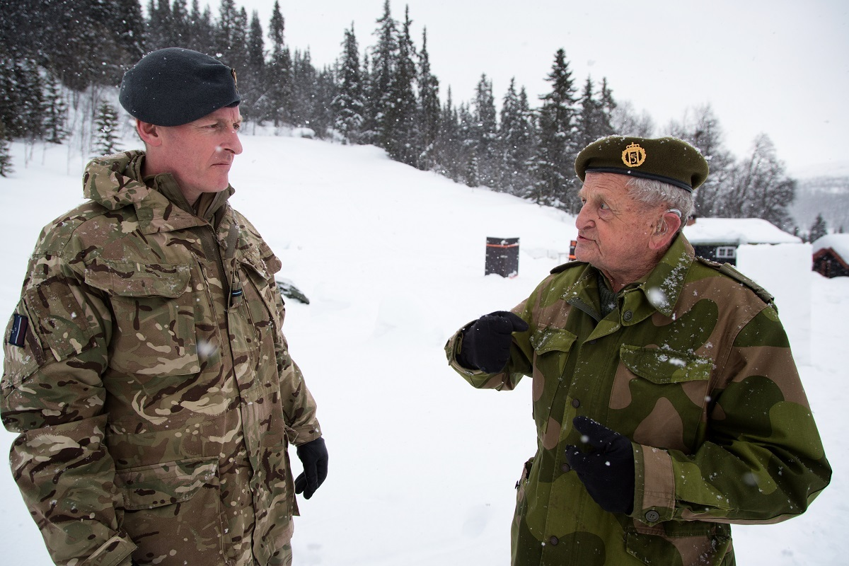 Fg Off Martin Wade with a surviving member of the wartime Norwegian resistance, Jan Høegh, 95, who remains an honorary member of the Norwegian Army Reserve . Pic: SAC Lloyd Horgan..