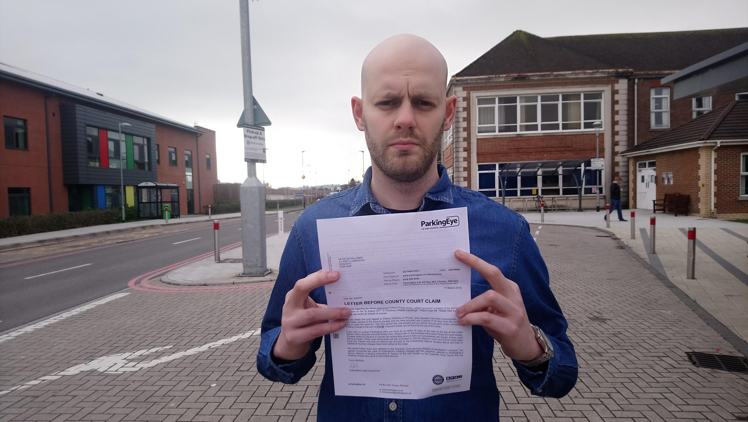 Kevin Williams stands in his parking zone at Llandough Hospital