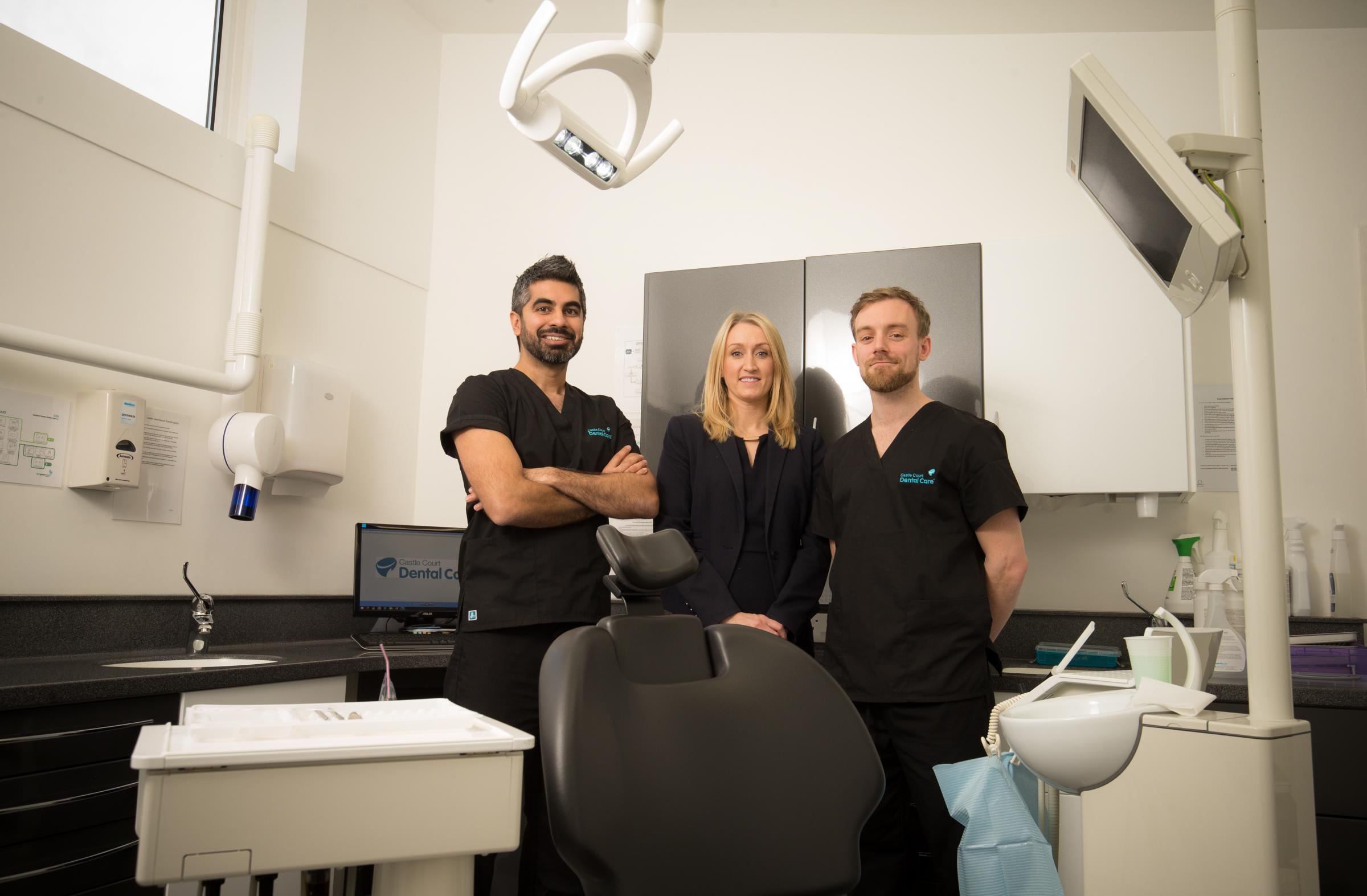 Suzanne Rees, Lloyds Bank Commercial Banking Healthcare Relationship Manager, with Principle Dentists Baharat Nagrani (left) and Eifion Roberts (right)