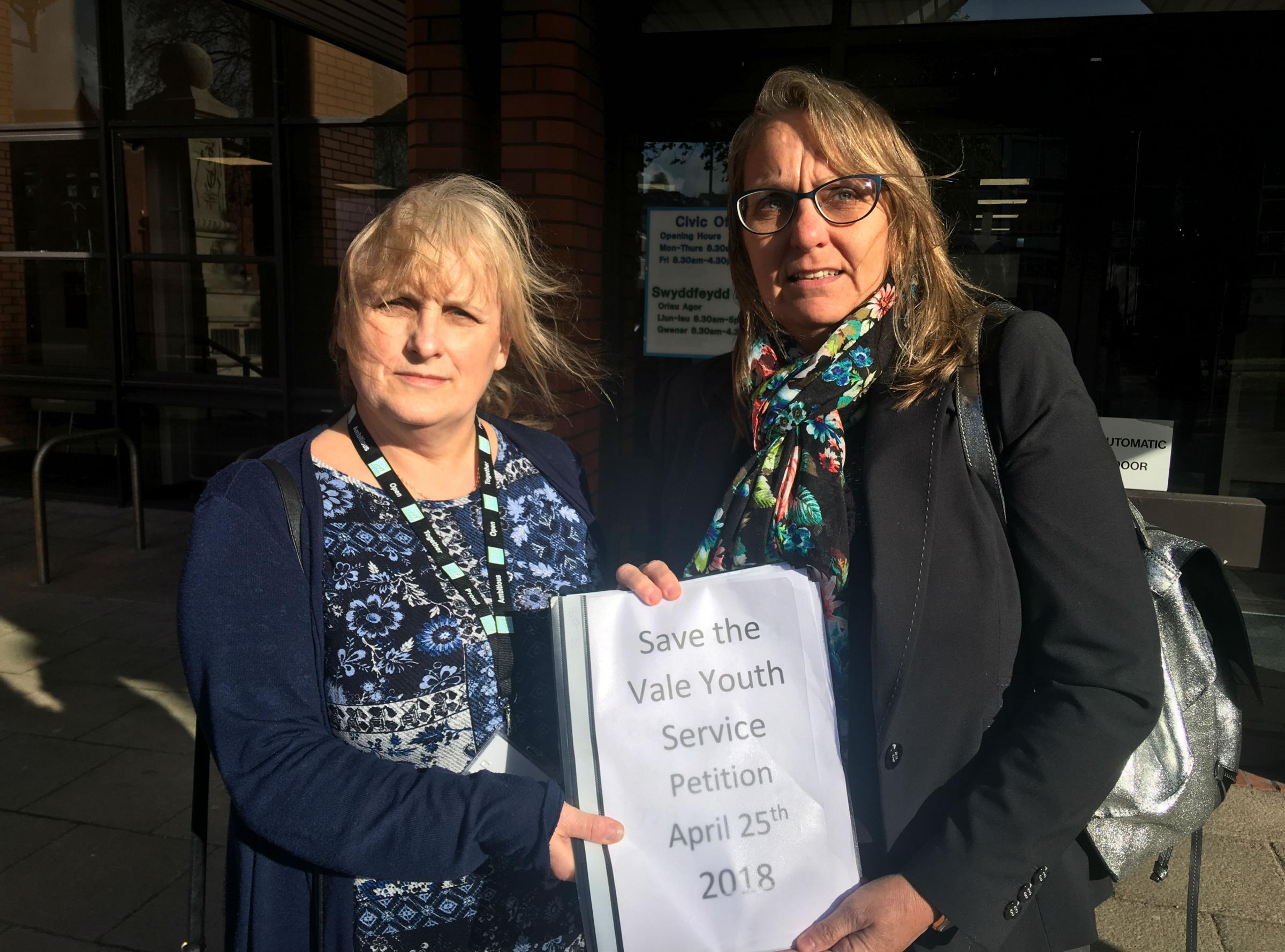 L to R councillors Sandra Perks and Helen Payne with petition against youth service cuts in VoG.jpg