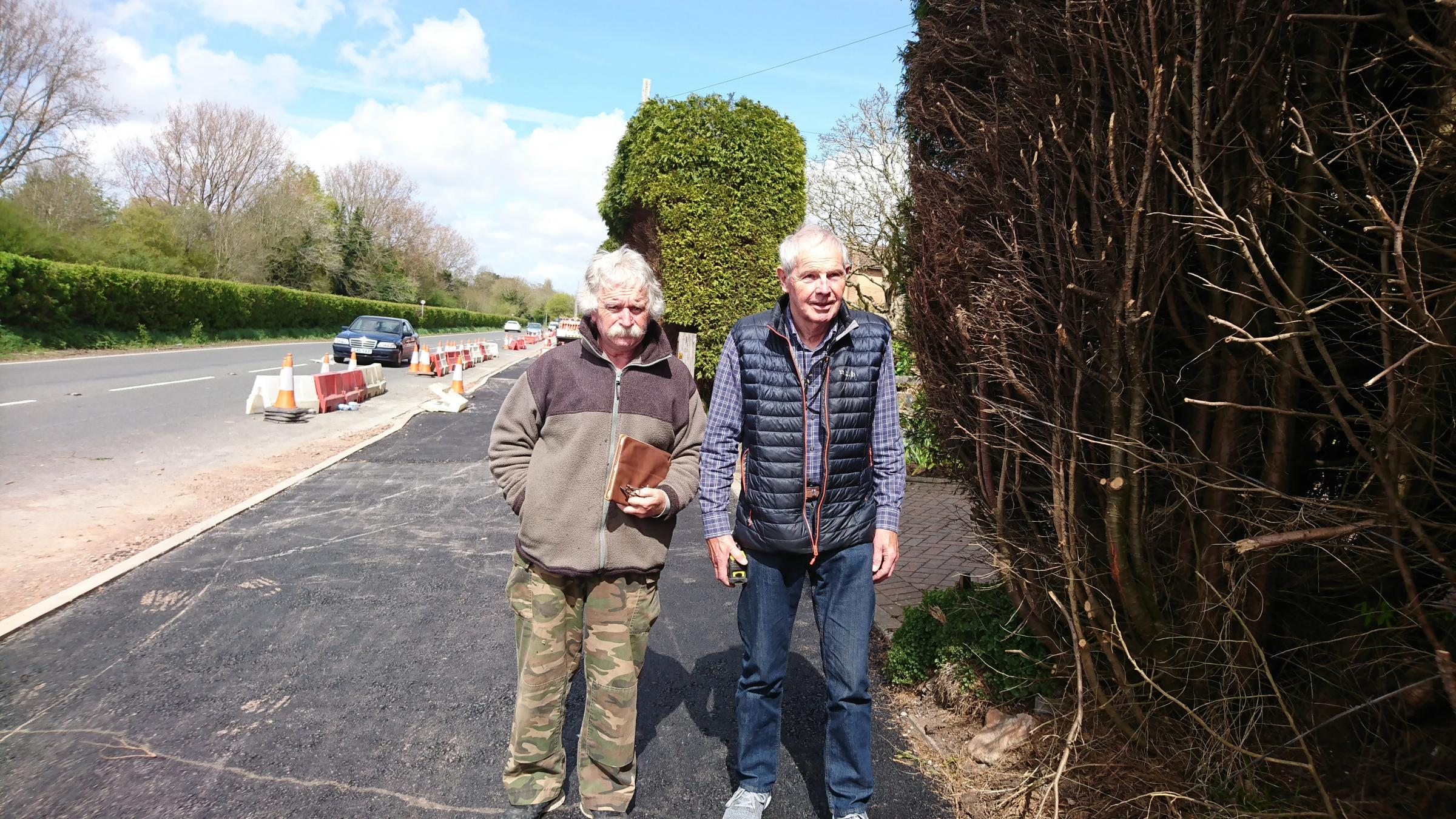 Jon Dewis and Mark Martin outside Mr Martin's house where his hedge has been cut back