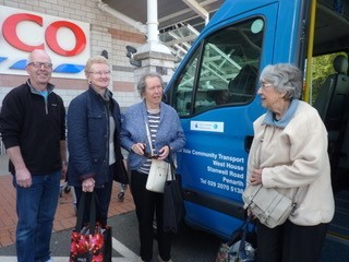 Paul Morris, EVCT volunteer driver, with some Llandough residents on their weekly shopping trip
