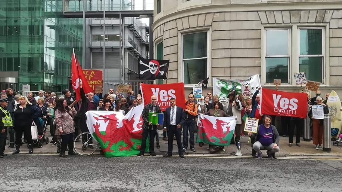 Campaigners outside Cardiff Crown Court with AM Neil McEvoy and musician Cian Ciaran